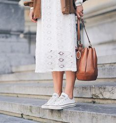 These classic white Chuck Taylor Converse go a treat with a white laced dress and leather accessories. Via Clochet. Brands not specified.