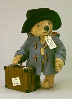 """*""""PADDINGTON BEAR"""" ~ 15"""" T, fully jointed, alpaca plush w/glass eyes. Wearing Felt: duffel coat + bush hat, Includes custom leather suitcase w/contents. Date of release: 2000. limited edition 2500. The first 500 pieces in the edition featured a certificate of authenticity personally signed by Paddington Author: Michael Bond, made by: Paddington & Co. Ltd. 2000 klicnsed by copyrights Group."""