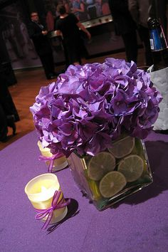 centerpiece... something like this and replace lemons with blueberries OR do blue flowers with some purple and put purple glass marble type glass rocks in the vase. Very pretty and easy.