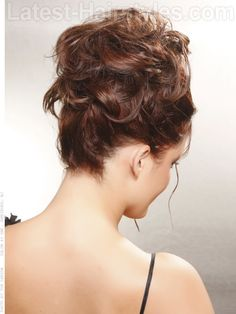 How To Style:  Part hair in the middle. Use a 1-inch curling iron to add curls throughout (or define your own). Secure hair up into a semi-high ponytail. Pin some curls haphazardly near the base of the ponytail to hide the elastic. Spray with medium or high hold hairspray for all-night hold.