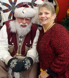 santa claus sporting his miracle mittens takes a quick break to chat with nancy miracle mittens partner at the maryland christmas show - Maryland Christmas Show