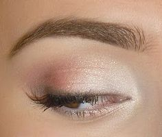 Subtle white and pink eye makeup, great for an understated look.
