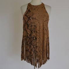 Black Bead Faux Suede Tank Snake print faux suede tank top by Black Beaded. Fringe trim. Asymetric Front. Fabric: Polyester/Spandex. New with tag. Size Small. Retail - $48. Black Bead Tops Blouses