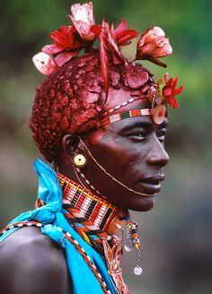 """mysleepykisser-with-feelings-hid: """" Carol Beckwith & Angela Fisher, Samburu Warrior Adorned with French Silk Roses, Kenya. A Samburu warrior from Kenya is expected to be strong, noble and courageous in character, but being Samburu also means he will. Kenya, Africa People, Anthropologie, Tribal People, French Silk, African Tribes, African Culture, New Africa, Tribal Fashion"""