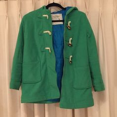 CHILD'S green coat Green coat with blue lining. I absolutely loved this coat when I was younger it's super warm and cozy but is sadly too short for me now.   For a better deal and free shipping go to the appmercari and enter KMPPDE for $2 off :) Old Navy Jackets & Coats Pea Coats