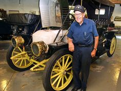 Tom Marshall stands next to a 1910 Stanley Steamer, one of 15 in his collection. RON CORTES / Staff Photographer