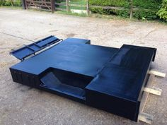 Tub welded up and painted in black stone chip primer
