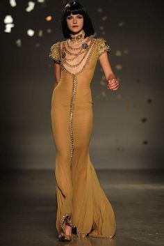 Interesting gold gown by Georges Hobeika.