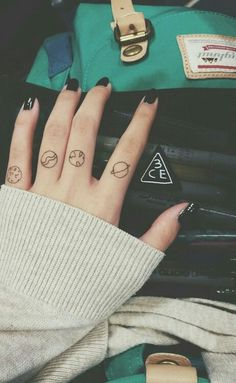 Solar system planet tattoos  Tiny solar system planet tattoos on fingers