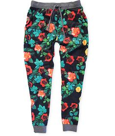 Brighten your outfits with a colorful sublimated floral rose print on a black colorway with a soft fleece lining and elastic cinched knit ankle cuffs.