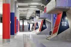 At France's Parc Olympique Lyonnais, a stadium by Nac?o Architecture and Populous, a concrete structural column on the main concourse bears an epoxy-painted portrait of 19...