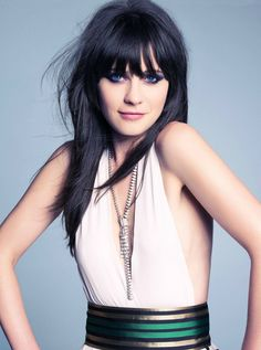 """Zooey Deschanel is... Words can't describe what I feel for her. I see her, and I'm reminded there's always a reason to smile. Because """"Life's a playground."""" :D"""