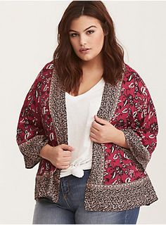"""Whether you live the beach lifestyle year-round or dream of making the great escape, this kimono will be your travel buddy. The cropped length makes it an easy slip-on-and-off style, with breezy and movable magenta challis that is bound of adventure with a border and paisley print.<div><br></div><div><b>Model is 5'8"""", size 1<br></b><div><ul><li style=""""list-style-position: inside !important; list-style-type: disc !important"""">Size 1 measures 29"""" from shoulder</li><li style=""""list-style-"""