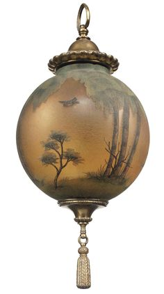 A BRASS MOUNTED OPALESCENT GLASS HANGING-LIGHT  OF REGENCY STYLE, CIRCA 1920  The spherical glass shade painted with birds and trees