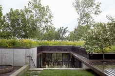 Stained cedar, ipe, and concrete form the 2,500-square-foot home's modern palette. Indigenous wildflowers and native grasses grow on…