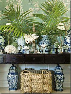 I could try this on my entry table--loads of blue and white, glass globes, sea creatures, basket beneath--not sure about the fronds.