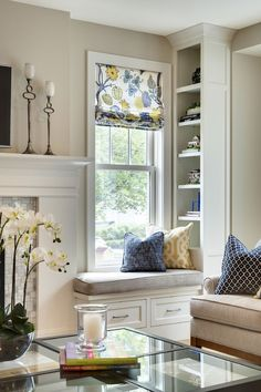 I love this whole look, the window seat, the shelving, the patterned window treatments...yes please!