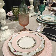 Hard to beat the beauty of a mismatched china place setting.  #thepinkbride #musiccitycenter #nashville #weddingrentals #pink #mismatchedchina #rehearsaldinner #wedding #table