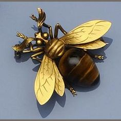 A French bee brooch with tiger eye; the bee is a symbol of productive industry. (Bonhams) ~dl~