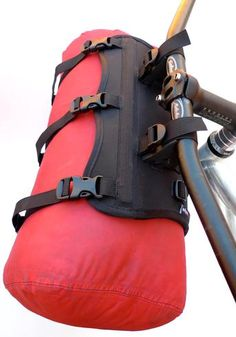 """The Harness is a rigid mount designed to carry drybags, stuff sacks or other cylinderical shaped objects (packrafts…) on your handle bars. Think of the Harness as a """"soft"""" rack…"""
