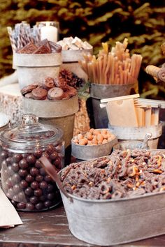 Rustic theme dessert bar- I'd have a brown portion (caramels and chocolates) for burlap, and a cream portion (coconuts, marshmallows, popcorn) for lace