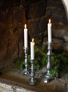 Tall candle sticks on ornate candle holders like these.