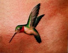 most realistic hummingbird tattoo I've seen yet