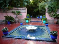 A view of a courtyard in the famous Jardin Majorelle of Marrakesh, designed and built by the french artist Jacques Majorelle, then later restored to splendor by Yves St. Laurent and Pierre Bergé