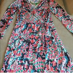 Lilly Pulitzer Faux Wrap Dress Amazing condition and quality. Bought from another posher but it is too small for me :( Lilly Pulitzer Dresses Mini
