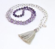 "beautifully shaded dark & light Purple Amethyst and Clear Quartz Crystal. Expertly hand knotted on Luminous Grey Silk Thread, and finished with a Silk and Cotton Tassel and a Custom, hand-stamped Sterling Silver Initial Charm-Also available in 14K Gold Fill. Made with 108, 6mm Amethyst and Quartz Crystal Gemstone Beads. This Mala measures 35"" in diameter and hangs 17.5"" in length."
