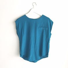 🐋 Vintage silk top Vintage teal silk top. Flattering cut, hits at the waist, button closure in the back. Great condition for vintage, but does have minor markings and discoloration, noted in last photo. Labeled size M, but fits more like a S. Vintage Tops Tunics