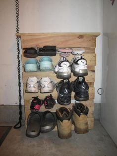 Thanks to Pinterest for the great idea for a pallat! So happy to have this shoe rack in my garage - thanks to my husband for helping me cut it!