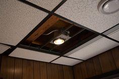 Installing lightbulb during recessed lighting installation Drop Ceiling Basement, Drop Ceiling Lighting, Basement Lighting, Ceiling Lights, Ceiling Panels, Ceiling Tiles, Dropped Ceiling, Basement Renovations, Types Of Lighting