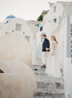 Photography: KT Merry - www.ktmerry.com Read More on SMP: http://www.stylemepretty.com/2016/03/29/these-photos-will-convince-you-to-elope-in-santorini-asap/