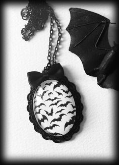 A dramatic gothic necklace featuring a black and white glass cameo of a cloud of little black bats on a white backgroun. Set in a pretty black metal oval frame and finished with a little black satin bow. Goth Jewelry, Jewelry Gifts, Unique Jewelry, Gothic Jewellery, Natural Jewelry, Jewelry Box, Jewelry Necklaces, Cameo Necklace, Dog Tag Necklace