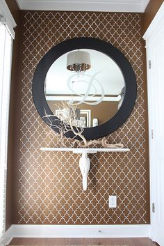 Love the monogrammed mirror, driftwood branch -- basically everything! For the wall at the end of a hallway