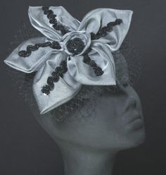 Silver Starfish. I wish hats were common to wear in the US for weddings and other events :-/