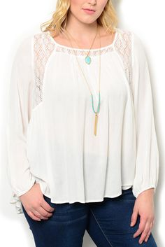http://www.dhstyles.com/Ivory-Plus-Size-Dressy-Sheer-Paneled-Floral-Lace-T-p/kati-8839x-ivory.htm