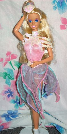 1989 Ice Capades Barbie- This was my favorite barbie and my little sister ripped her head off.