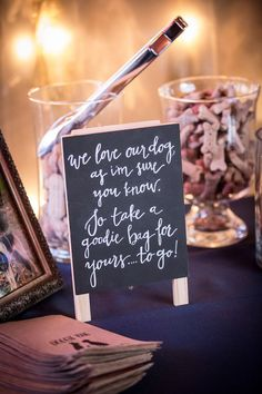Dog treat wedding guest favors. View more from this modern Nashville wedding with an urban downtown theme and soft lavender details. Pics by @tylernicolephot | The Pink Bride® www.thepinkbride.com #nashvillewedding