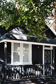 """The home's exterior facade is painted in Dulux 'Domino'. """"I really wanted the house to be dark, which is similar to the little summer cottages you see on the lakes in Sweden,"""" says Libby. Design Exterior, Exterior Paint Colors, Exterior House Colors, Paint Colors For Home, Paint Colours, Exterior Doors, Exterior Stairs, Coastal Living Rooms, Coastal Cottage"""