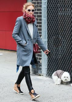 Olivia Palermo makes dog walking look like a high-fashion sport.