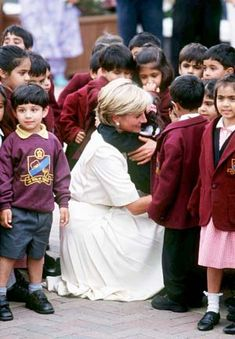This photo of Diana greeting London schoolchildren was taken in June 1997, just two months before her tragic death in Paris. Her breezy white dress signaled a more relaxed -- and happier -- time for Diana.