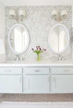 master vanity diamond tile backsplash, light blue floating vanity, Caesarstone countertop and of course lots of white!