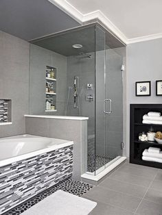 Sheathed in oversize ceramic tile, the shower is grounded with a textured river rock floor. A rain-style showerhead and handheld wand enhance showering. The same linear tile on the vanity backsplash covers the tub surround and niche, adding a third layer Dream Bathrooms, Beautiful Bathrooms, Small Bathrooms, White Bathrooms, Luxury Bathrooms, Narrow Bathroom, Master Bathrooms, Tiled Bathrooms, Bathrooms Decor