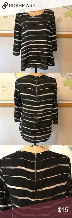 Express Black and White Striped Blouse Express Black and White Striped Blouse. Half zip up the back. 3/4 sleeve. Light sheer material. Tag says M, but will fit a M/L. New and never worn, but tag cut off.  *All proceeds will go towards medical supplies for families who don't otherwise have access to good medical care. I greatly appreciate your help and support! Express Tops Blouses