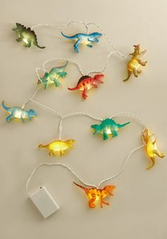 Important Extinction to Make String Lights - It's important to know the difference between a toy an a perfectly reasonable interior item with which an adult should decorate. These dinosaur string lights from Disaster Designs are the latter, obviously! Ten vibrantly painted, actively rawring dinos are strung along white wire, showcasing your playful personality via your decor decisions.