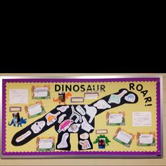 A dinosaur bulletin board. The skeleton is made up of the kid's drawings of their favorite dinosaurs.