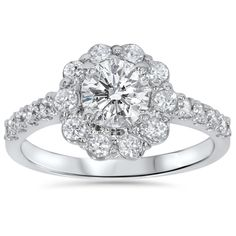 Enhance your proposal with this beautiful floral diamond engagement ring. A large round diamond surrounded by a ring of smaller stones creates a romantic flower effect for a feminine touch. More daint