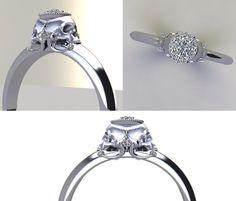 Double skull engagement ring